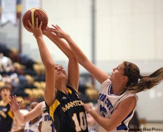 Team Manitoba's Emily Potter tangles with Team Nova Scotia's Alison Keough, right, during action at the National Women's National Championships at the University of Manitoba in 2011.