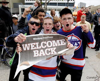Young hockey fans celebrate the return of the NHL to Winnipeg in the spring of 2011.