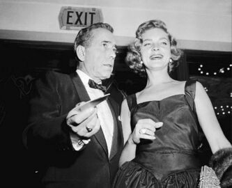 Actress Lauren Bacall and her husband, Humphrey Bogart, in 1955. Bacall died Tuesday in New York.