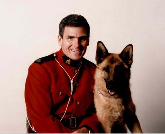 Retired Mountie Ken Barker, seen with police dog Axa, took his own life after suffering from post-traumatic stress disorder. One of the horrors he witnessed was the beheading on a Greyhound bus in 2008