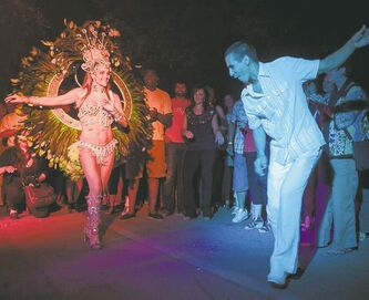 Marcia Monteggia dances with Tom Cardaso during the inaugural Carnaval on Bannatyne Avenue Saturday night.