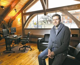 Mike Deal / Winnipeg Free Press Hugh Hull in the Summer House Business Centre , a project that took three years to complete.