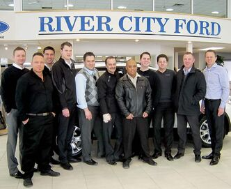 River City Ford dealer principal Trevor Boquist (far right) and general sales manager Ryan Monczunski (fifth from left) with sales staff.
