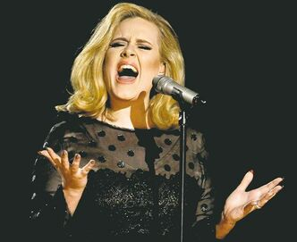 FILE - In this Feb. 12, 2012 file photo, Adele performs during the 54th annual Grammy Awards in Los Angeles. The British singer's