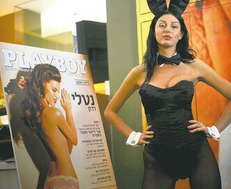 A model dressed as a Playboy bunny poses with the first Hebrew language edition of the popular men�s magazine in Tel Aviv, March 5.