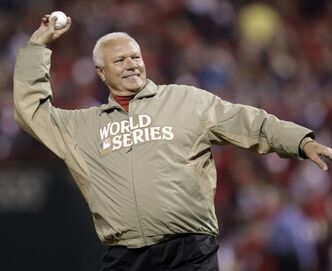 FILE - In this Oct. 28, 2011 file photo, former St. Louis Cardinals pitcher Bob Forsch throws out the ceremonial first pitch before Game 7 of baseball's World Series against the Texas Rangers, in St. Louis. Forsch, who threw two no-hitters for the Cardinals and is the third-winningest pitcher in team history, died Thursday, Nov. 3, 2011 at his home near Tampa, Fla. He was 61. (AP Photo/Matt Slocum, File)