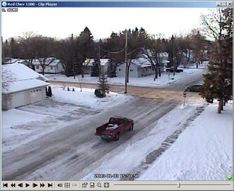 Surveillance of a stolen red truck used in a robbery in Steinbach on Jan. 3.