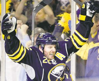 FULL CLOSE CUT CLOSECUT - Buffalo Sabres' Thomas Vanek (26) of Austria, celebrates his goal against the Philadelphia Flyers during the first period in Game 6 of a first-round NHL Stanley Cup playoffs hockey series, in Buffalo, N.Y., Sunday, April 24, 2011. (AP Photo/David Duprey)