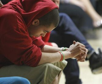 Eddison Clayton, a student at Grant Park High School, listens to the MADD presentation Friday.
