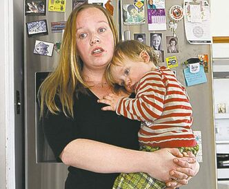 Mickie Chapman and her son, Cohen. 'Why can't they leave us alone?'
