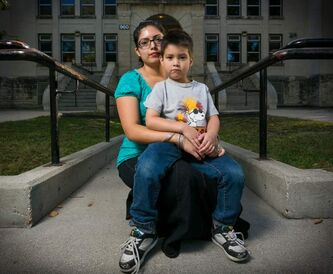 Belhen Rojo and her four-year-old son, Jacob, in front of Laura Secord School in Wolseley. Jacob spent the whole day in the wrong school.