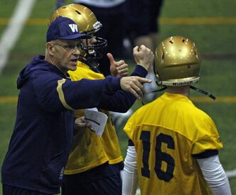 Bombers offensive co-ordinator Gary Crowton makes sure rookie QB Max Hall is on the same page during mini-camp at the Winnipeg Indoor Soccer Complex.