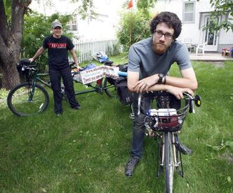 Caley Fox (right) and Shannon Hutchinson are cycling across Canada on tandem bicycles, looking for people to ride along with them.