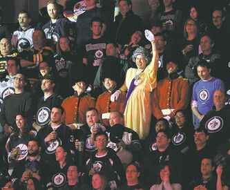 Queen Elizabeth II makes an unexpected appearance at Friday night's Jets game. The winsome beauty graced the MTS Centre crowd with a wave of her elegantly gloved hand during the singing of the Canadian anthem.