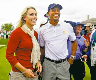 U.S. team player Tiger Woods smiles with girlfriend Lindsey Vonn after the  U.S. won the Presidents Cup at Muirfield Village Golf Club in Ohio Sunday .