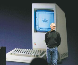 Apple co-founder Steve Jobs stands in front of an image of an early Apple desktop computer in 2007. He died in 2011.