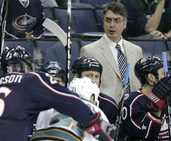 Columbus Blue Jackets interim coach Claude Noel, top, watches his team during the  first period of an NHL hockey game against the San Jose Sharks in Columbus, Ohio, Wednesday, Feb.10, 2010.