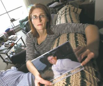 Corinne Staple holds a photo of her brother, Brent Staple, who disappeared in 2009.