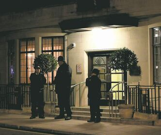 Sang Tan / The Associated PressBritish police officers stand guard outside King Edward VII hospital Sunday in London where Queen Elizabeth II  was admitted to be assessed for symptoms of gastroenteritis. She may have to be rehydrated intravenously.