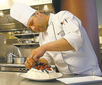 Chef Jonathan Royal prepares pavlova at Jane's Restaurant.