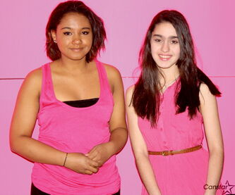 Elmwood High School Grade 11 student Christine Wilkie and Grade 8 student Sophie Rivera are shown in the pink photo booth the school set up for the Day of Pink to raise awareness of bullying, discrimination, homophobia, and transphobia in schools.