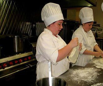 Get Ready to Work! participants Emily Hopps and Lena Montgomery make pizza dough.