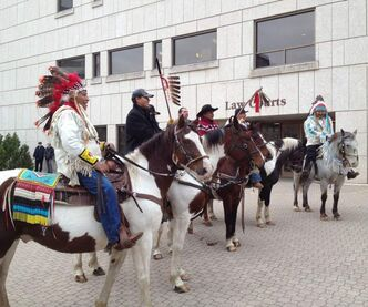 Supporters arrived on horseback at the Law Courts in downtown Winnipeg this morning.