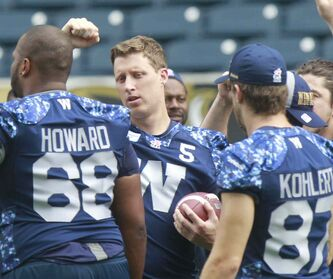 Winnipeg Blue Bombers quarterback Drew Willy is the centre of attention at the team's walk-through session at Investors Group Field Thursday.