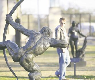 People walk through the Sydney Walda Besthoff Sculpture Garden in City Park in New Orleans.