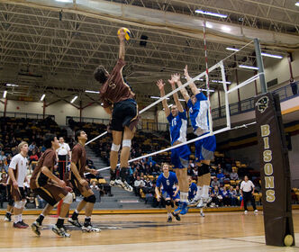 University of Manitoba Bisons Dane Pischke (#5) spikes the ball against the University of Brandon Bobcats in this Feb. 20, 2011 file photo.