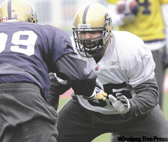 New Blue Bombers offensive lineman Qasim Khan, 6-foot-4 and 310 pounds, works out with the team at practice Friday.