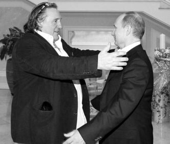 Gerard Depardieu, left, greets Russian President Vladimir Putin at the president's residence in Sochi.