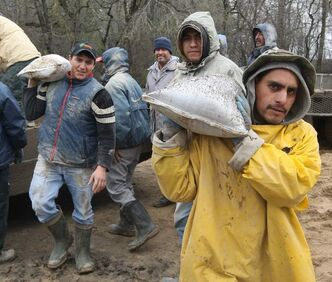 When the 2011 Assiniboine River flood halted an asparagus harvest near Portage la Prairie, migrant workers from Mexico helped out sandbagging.