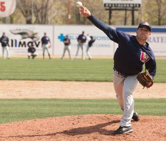 New Goldeyes pitcher Kaohi Downing pitches on the first day of training camp at Shaw Park on Saturday.