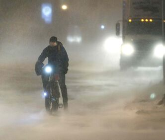 A cyclist braves the elements in downtown Winnipeg.
