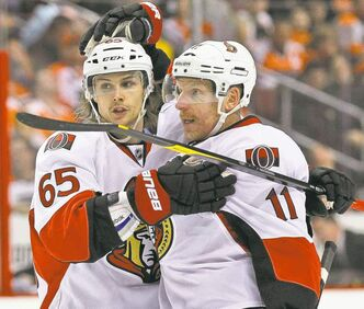 Ottawa Senators defenceman Erik Karlsson (left), last season's Norris Trophy winner, could yet rejoin teammate Daniel Alfredsson this season.