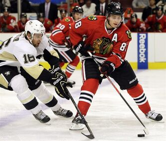 Chicago Blackhawks' Patrick Kane, right, controls the puck against Pittsburgh Penguins' Brandon Sutter during the second period of an NHL preseason hockey game in Chicago, Thursday, Sept. 19, 2013. Daniel Alfredsson, Roberto Luongo and Kane are among the top 10 NHL players to watch in 2013-14. THE CANADIAN PRESS/AP/Nam Y. Huh