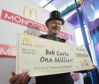 Bob Curle with his cheque.