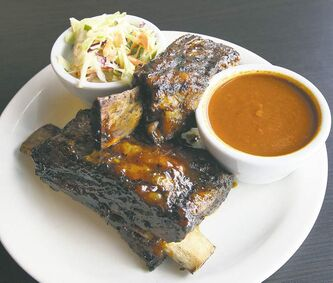 The massive beef bones,  with cole slaw and tomato soup as sides,  had  just enough of the house barbecue sauce.