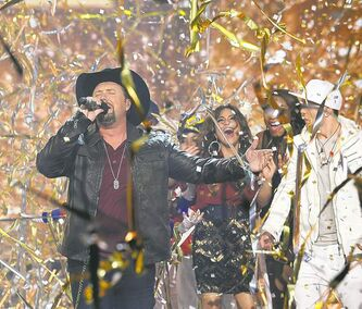 Tate Stevens performs during The X Factor finale.