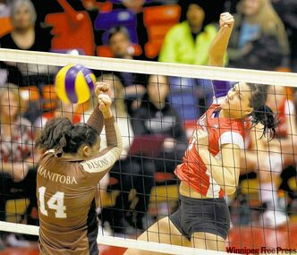 Winnipeg's Erika Buchanan (right) hammers the point home at Manitoba's  Christina Souza Wednesday night.