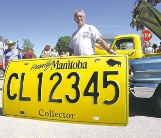 Bob Chubala from the Manitoba Association of Auto Clubs with a super-sized version of Manitoba's upcoming collector car licence plate.
