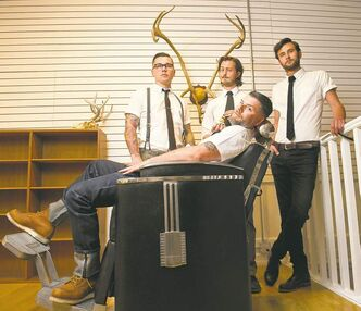 Dru Barrow (left), Walter Spooner, Jeremy Regan and Mason Melle are barbers at Hunter and Gunn.