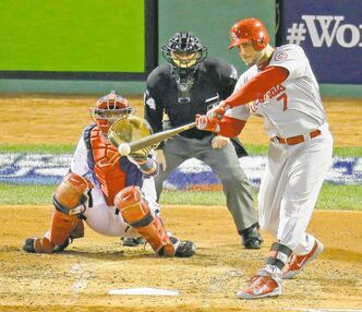 St. Louis Cardinals' Matt Holliday rips a triple during the fourth inning of Game 2 at Fenway Park on Thursday night.