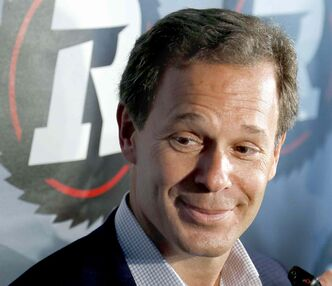 The commissioner of the CFL Mark Cohon talks to reporters in front of the logo for the Redblacks after a ceremony to to announce the name and logo for the new Ottawa CFL football franchise in Ottawa on Saturday, June 8, 2013. THE CANADIAN PRESS/ Patrick Doyle closecut close cut