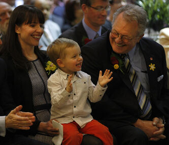 Spencer, 2, with mom Lea Ledohowski, shows his approval at the opening of his grandfather's newest hotel, Canad Inns Destination Centre Health Science Centre.