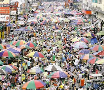 Filipinos crowd a market area as they make their last minute shopping on Christmas eve in Manila, Philippines Saturday Dec. 24, 2011. Christmas is one of the most important holidays in this predominantly Roman Catholic nation. (AP Photo/Aaron Favila)