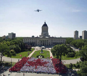 An aerial view at the Living Flag event held last year at the legislature. Canada Post put a picture of it on a stamp.