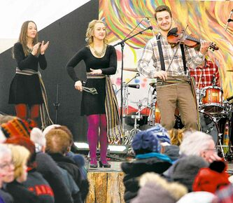 Big crowds packed the tents during the final day of the Festival du Voyageur to take in performances by groups such as Ça Claque!, with Nicolas Messener on the fiddle and Stéphanie Touchette on the spoons.