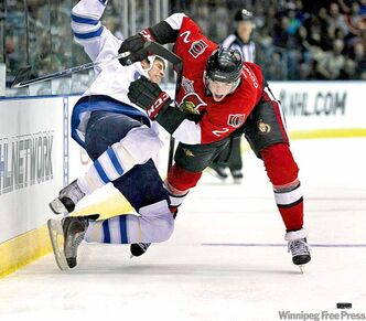 Senators defenceman Jared Cowen sends Jet Troy Bodie flying.